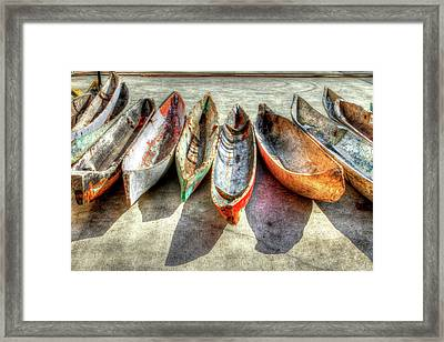 Canoes Framed Print by Debra and Dave Vanderlaan