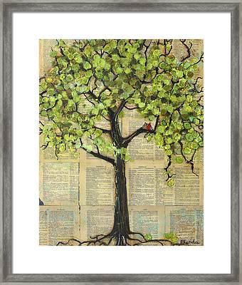 Cardinals In A Tree Framed Print by Blenda Studio