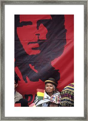 Caring Che Framed Print by James Brunker