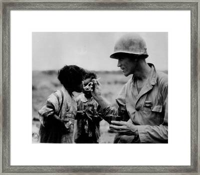 Caring Solider Framed Print by Retro Images Archive