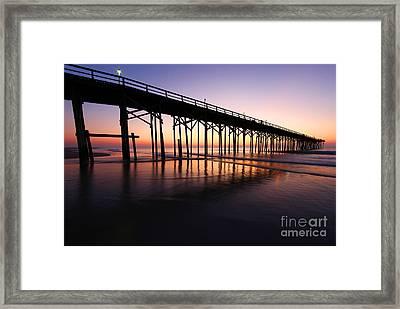 North Carolina Beach Pier - Sunrise Framed Print by Wayne Moran