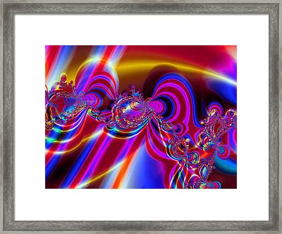 Carousel Colours Framed Print by Ian Mitchell