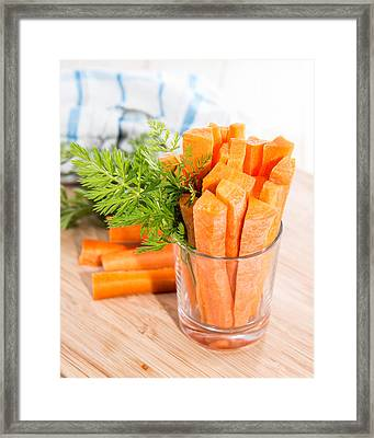 Carrot Sticks In A Glass Framed Print by Handmade Pictures