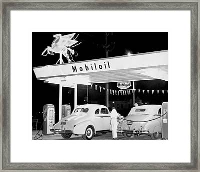 Cars At A Mobil Gas Station Framed Print by Underwood Archives