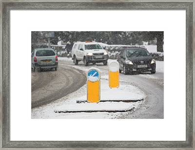 Cars Driving Through Heavy Snow Framed Print by Ashley Cooper
