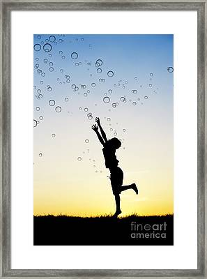 Catching Bubbles Framed Print by Tim Gainey