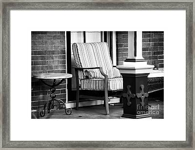 Chair On The Porch Framed Print by John Rizzuto