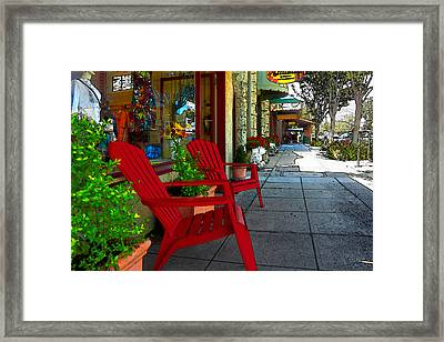 Chairs On A Sidewalk Framed Print by James Eddy