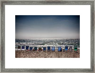 Chairs Watching The Sunset Framed Print by Peter Tellone