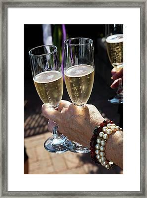 Champagne Celebration Framed Print by Jim West