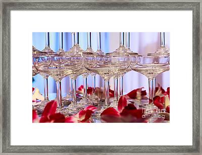 Champagne Glass Framed Print by Niphon Chanthana