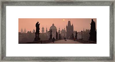 Charles Bridge At Dusk With The Church Framed Print by Panoramic Images