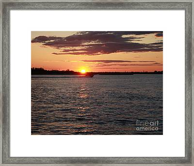 Chasing The Freeport Sunset Framed Print by John Telfer