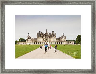 Chateau Chambord And Cyclists Framed Print by Colin and Linda McKie