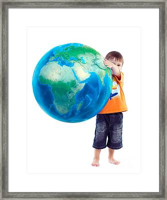 Child Holding World Earth Globe In His Hands Framed Print by Oleksiy Maksymenko
