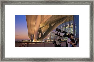 Child Looking Through A Telescope Framed Print by Babak Tafreshi