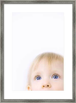 Child Looking Up Framed Print by Chris and Kate Knorr