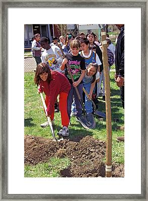 Children Planting A Tree For Earth Day Framed Print by Jim West