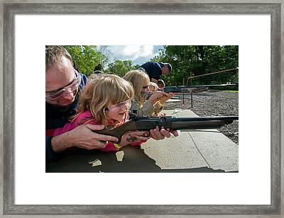Children Shooting Bb Guns Framed Print by Jim West