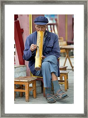 Chinese Man Smoking A Water Pipe. Framed Print by Tony Camacho