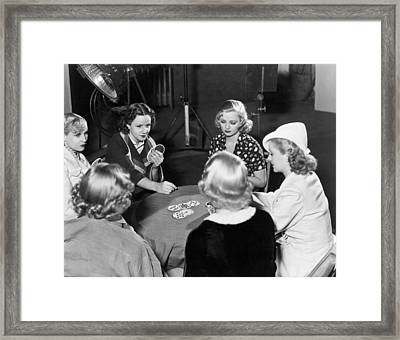 Chorus Girls Playing Hearts Framed Print by Underwood Archives