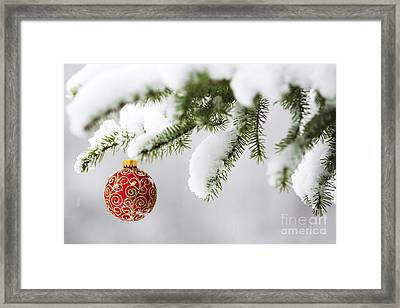 Christmas Ornament In The Snow Framed Print by Diane Diederich