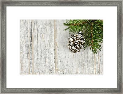 Christmas Ornament On Pine Branch Framed Print by Elena Elisseeva