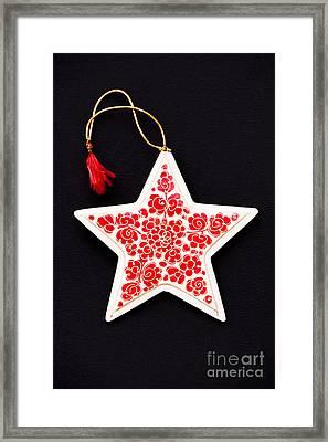 Christmas Star Framed Print by Anne Gilbert