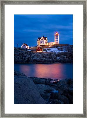 Christmas Time At Nubble Light. Framed Print by Jeff Sinon
