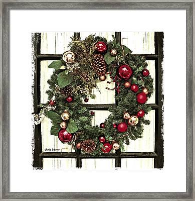 Christmas Wreath On Black Door Framed Print by Chris Berry
