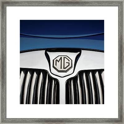 Chrome Radiator Grill And Badge Of Blue Framed Print by Panoramic Images