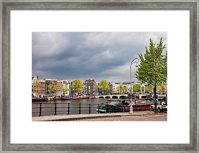 Cityscape Of Amsterdam In The Netherlands Framed Print by Artur Bogacki