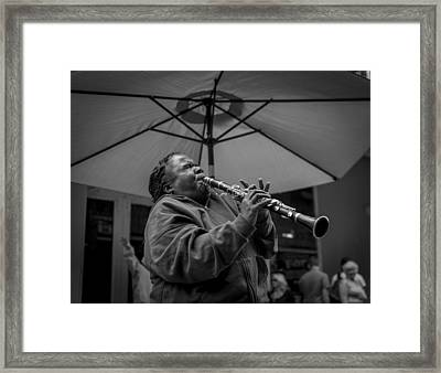 Clarinet Player In New Orleans Framed Print by David Morefield