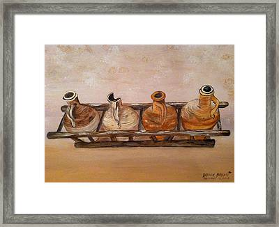 Clay Jugs In A Row Framed Print by Brenda Brown