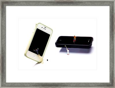 Cleaning The Iphones Little People Big Worlds Framed Print by Paul Ge