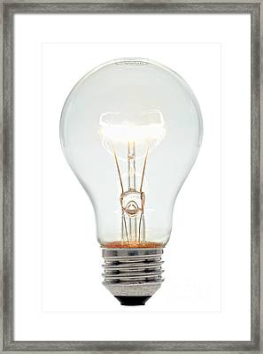Clear Light Bulb Framed Print by Olivier Le Queinec