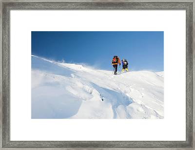 Climbers Being Blasted By Spindrift Framed Print by Ashley Cooper