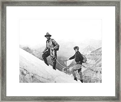 Climbing In The Rockies Framed Print by Underwood Archives