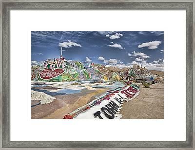 Climbing Salvation Mountain Framed Print by Hugh Smith