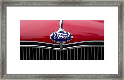 Close-up Of The Logo Of Fords Car Framed Print by Panoramic Images
