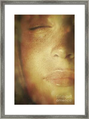 Close-up Of  Woman's Face In Dreamlike State Framed Print by Sandra Cunningham