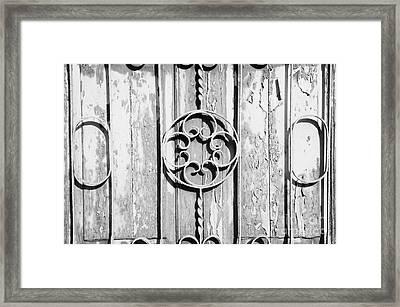 close up old weathered green painted wooden door entrance to abandoned house with wrought iron in Tacoronte Tenerife Canary Islands Spain Framed Print by Joe Fox