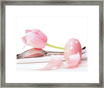 Closeup Of Tulip And Utensils On Pale Pink Framed Print by Sandra Cunningham