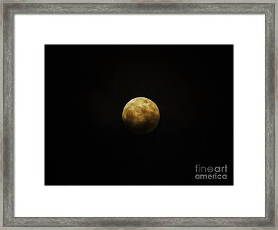 Clouds Across The Moon Framed Print by D Hackett