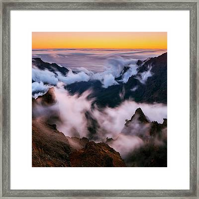 Clouds And Peaks Framed Print by Babak Tafreshi