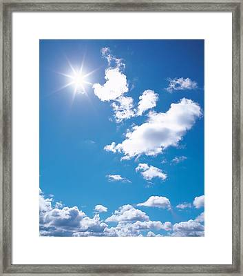 Clouds In Blue Sky, Lens Flare Framed Print by Panoramic Images