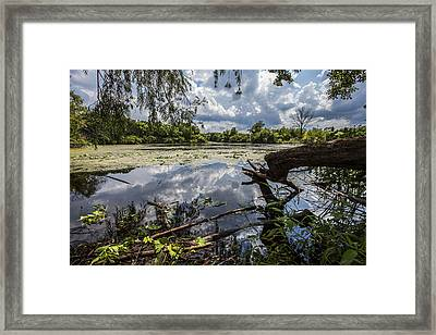 Clouds On The Water Framed Print by CJ Schmit