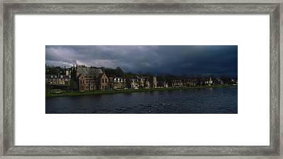 Clouds Over Building On The Waterfront Framed Print by Panoramic Images