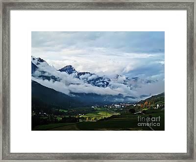 Clouds Over Pontresina Framed Print by Elvis Vaughn