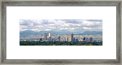 Clouds Over Skyline And Mountains Framed Print by Panoramic Images